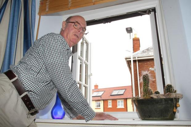 DOUG Human says he is fed up of sleepless nights caused by streetlights positioned right outside his bedroom window. PHOTO: Steve Guscott.
