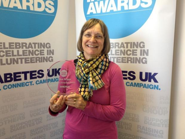 Sue Briggs with her award.