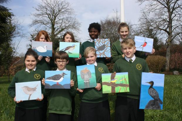 DULVETON Middle School pupils with their British bird paintings, from left, back: Erin Jones, Georgina Retallick, Lulu Agbami and Alex Kelly; front: Jessica Priest, Matthew Puttock, Freya Smith and Alexander Wright. PHOTO: Submitted.