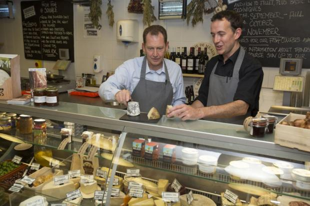 SIR Graham Watson MEP, left, enjoys some West-Country cheese at St Nick's Market in Bristol. PHOTO: Gareth Iwan Jones.