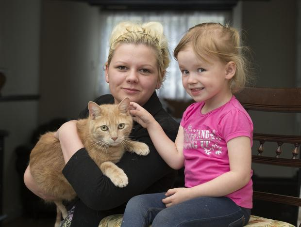 Sparkle Dodd with her cat, Chesney, and mum, Chelsea-Ann. Photo: Rowan Griffiths.