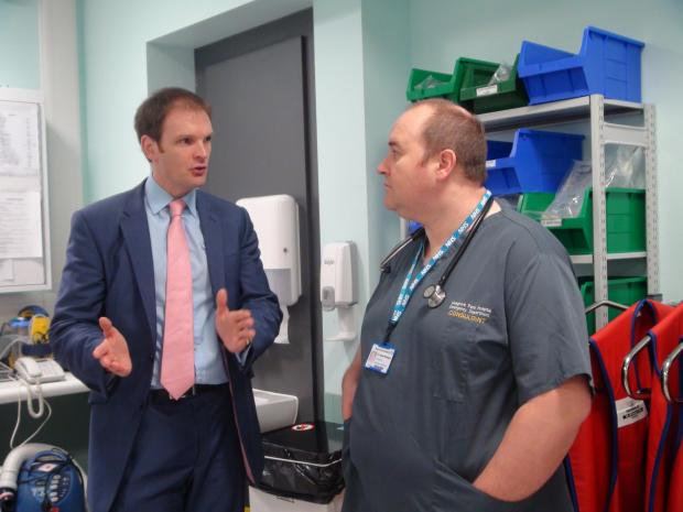 Somerset County Gazette: HEALTH Minister Dr Dan Poulter talking to emergency medicine consultant Alistair Billington.