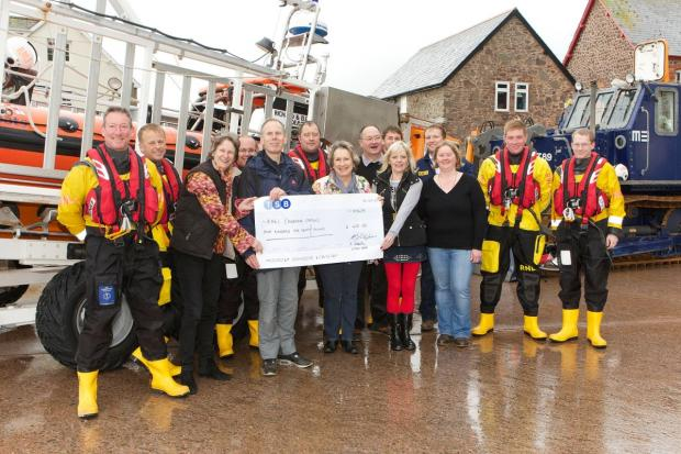 THE Exmoor Belles with some of Minehead's volunteer lifeboat crew. Photo: Peter Creech.