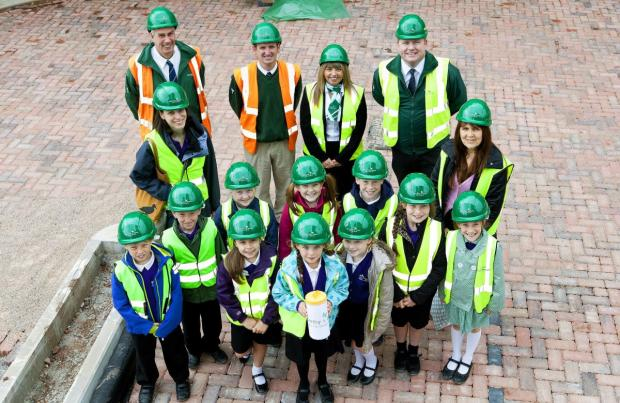 MINEHEAD First School pupils who have buried a time capsule at a retirement development in the town. PHOTO: Submitted.