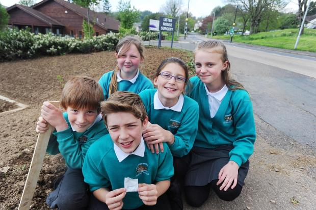 Planting the poppies at Croft Way, from left, back, Tilly, Rebecca and Jagoda; front, Ashley and Alex.