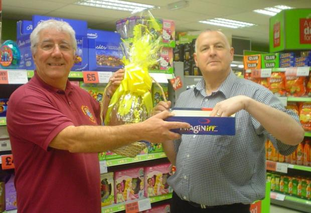 LION Steve Wells with Phil Leat, manager of the Williton Co-op drawing one of the winning tickets for Kirsty Fisher. PHOTO: Submitted.