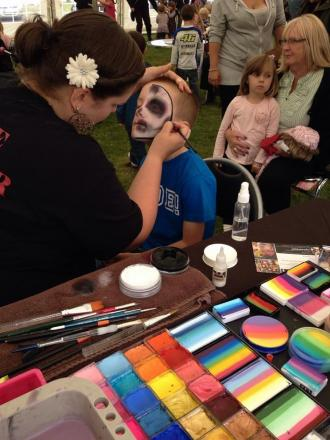 KATIE from Magic Minds gives Jack Middleton-Smith a spooky facepaint. PHOTO; Submitted.