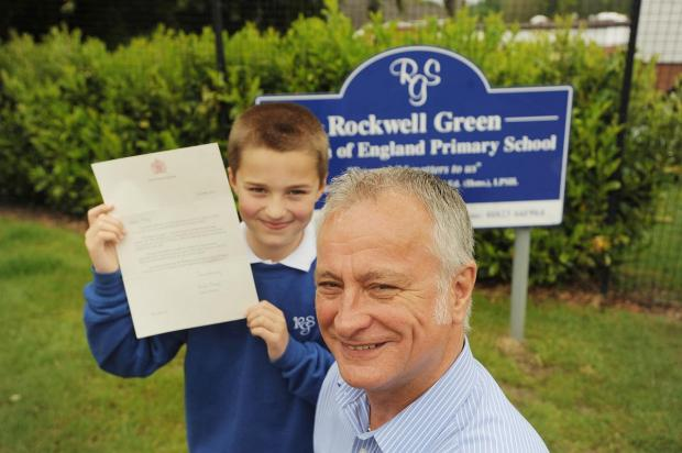 Riley Bowler holds up his letter from the Queen with Peter Williamson.