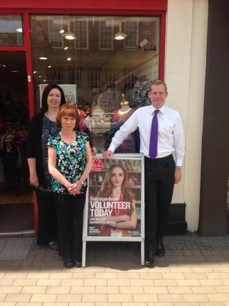 Jeremy Browne poses with staff outside the BHF shop in Taunton