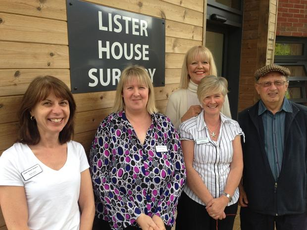 Outside the new surgery are, from left, lead dispenser Alison Davis, practice manager Emma Spiller, receptionists Helen Gouldson and Jackie McGovern, and Peter Berman, vice chairman of the patient group.