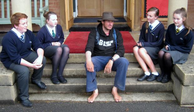 BAREFOOT poet Philip Wells, centre, joins students from left to right: Alfie Martin, Hattie Bohun, Cerys Rimmer and Becky Webb. PHOTO: Submitted.