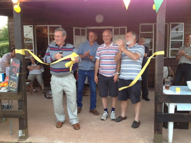 LYDEARD St Lawrence Cricket Club president Francis Darlow cuts a ribbon to officially open the club's new facilities.