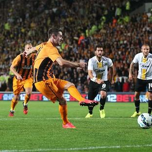 Robbie Brady, second from left, scores Hull's second goal from t