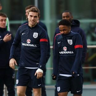 Jordan Henderson, pictured left, is thoroughly impressed by his England team-mate Raheem Sterling, right
