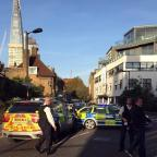 Somerset County Gazette: Police at the scene where a teenager was stabbed to death in south London
