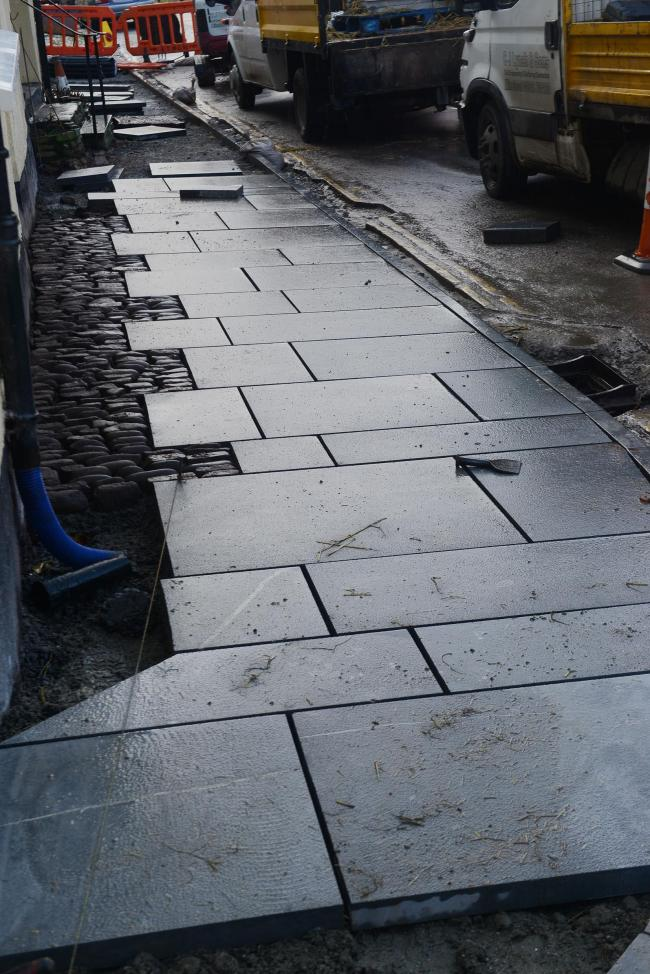 THE controversial slabs which are replacing cobbles in West Street.