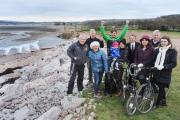 DELIGHTED supporters of the Seam Coast Trail Scheme celebrate the announcement that its application for cash grant has been successful.