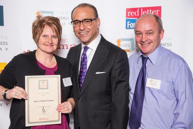 Former Dragon's Den investor Theo Paphitis, centre, with Karen Lang and Jamie Dobson, of Azana Photo Frames, of Taunton.