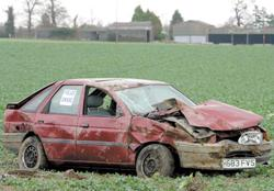 Somerset County Gazette: Wrecked - a car in a field beside the A120 between Wix and Ramsey. Picture: TERRY WEEDEN (53807-1)