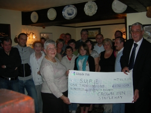 The cheque presentation at the Crown Inn