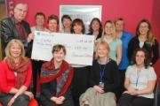 Social and Professional Studies staff are pictured presenting the cheque to SURE fundraiser Jeff Gale.