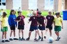 HAVING A BALL: Primary pupils enjoying the multi-sports event