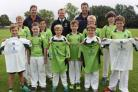 PHOTO: Youth players across the ages celebrate the new three-year deal with, rear from left, Taunton School's Head of Cricket, Dave Jessep, TDCC Treasurer, Steve Nelson, and Taunton School's head of cricket development, Marcus Trescothick, who is also