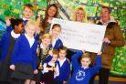 Parkfield Primary School pupils present cheque to Taunton Association for the Homeless