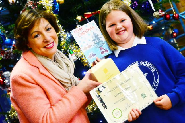 Parkfield School pupil top of the cards with her design for Rebecca Pow's Christmas card