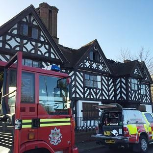 Fire crews outside the 17th century Stratford House building in Birmingham  following a fire on the