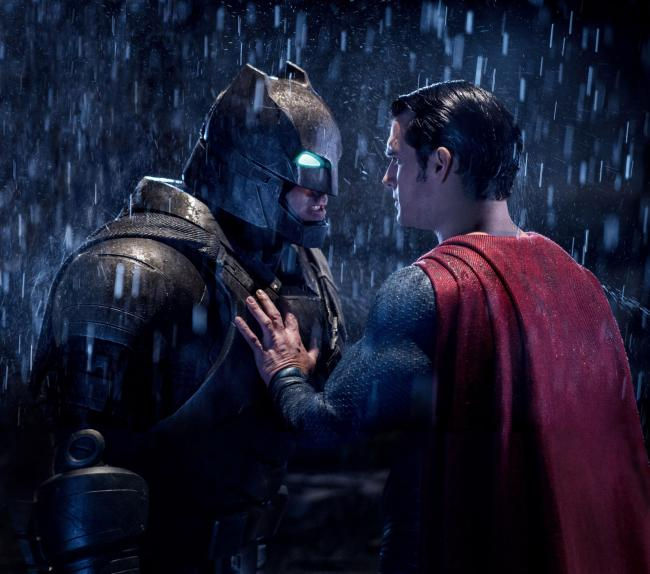Ben Affleck as Batman and Henry Cavill as Clark Kent/Superman. (PA Photo/Warner Bros)