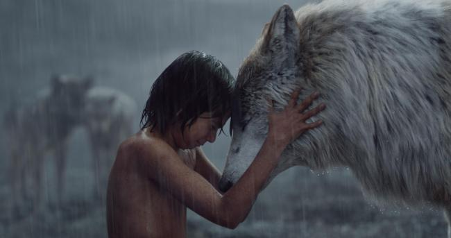 Mowgli (Neel Sethi) and Raksha (voiced by Lupita Nyong'o) share a tender moment.