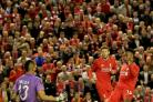 Liverpool's Daniel Sturridge, right, scores his side's second goal