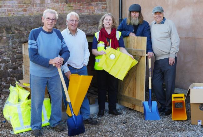 EQUIPMENT: Nicola Dawson of CRISP (centre) with Dunster Parish Council Flood Group members Geoff Witherford, Alan Vicary, Alan Rigler and Doug Challoner