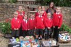 Pupils from St John's Primary School with Rosie Sandy from Taunton Association for the Homless