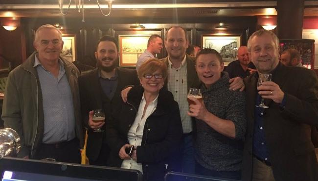 Staff celebrate a buyer stepping in to save Quantock Brewery.