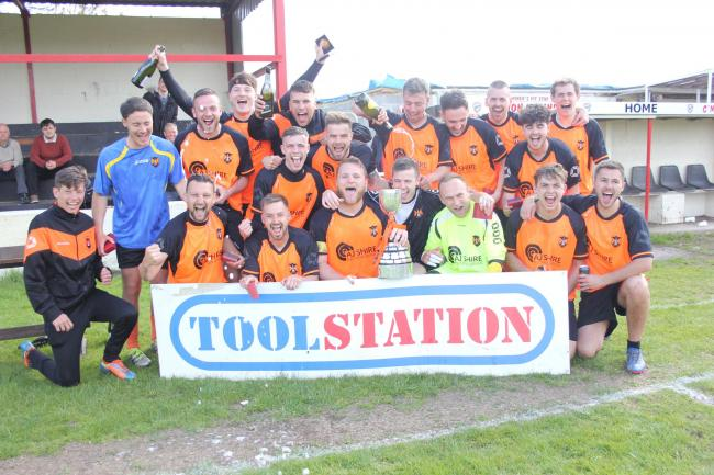 CHAMPIONS: Wellington celebrate their Toolstation Western League First Division title triumph