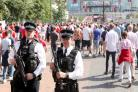 Fans met with heavy armed police presence ahead of Wembley FA Cup final
