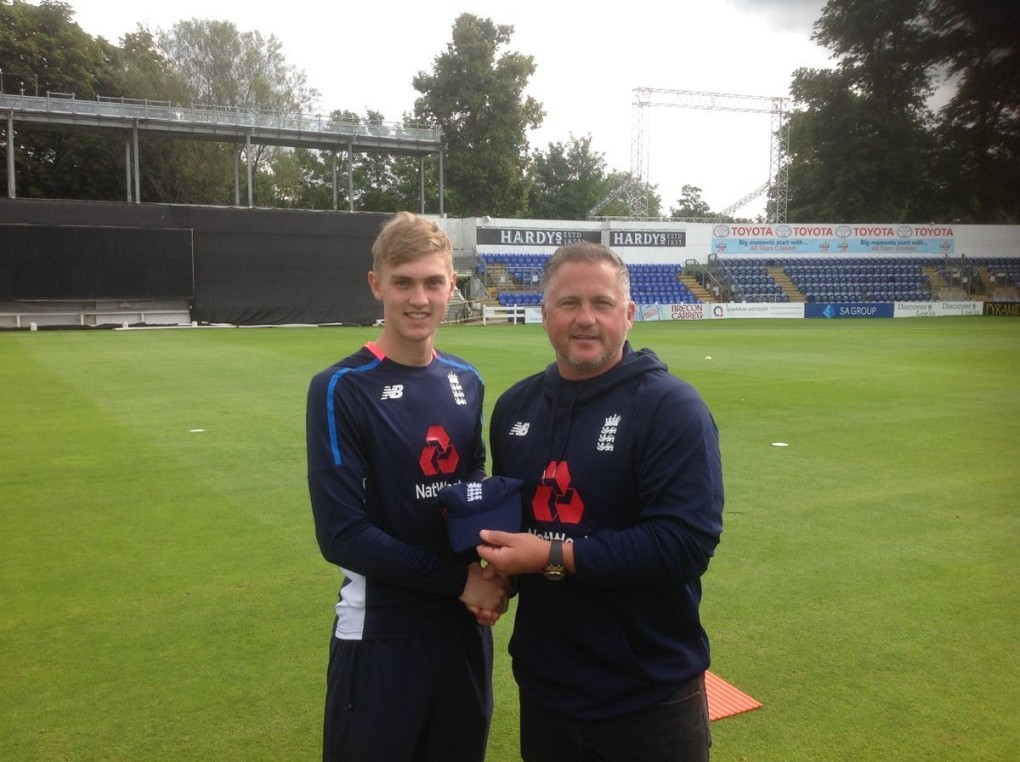 CAP: Tom Lammonby receives his England Under-19 cap from coach Darren Gough.