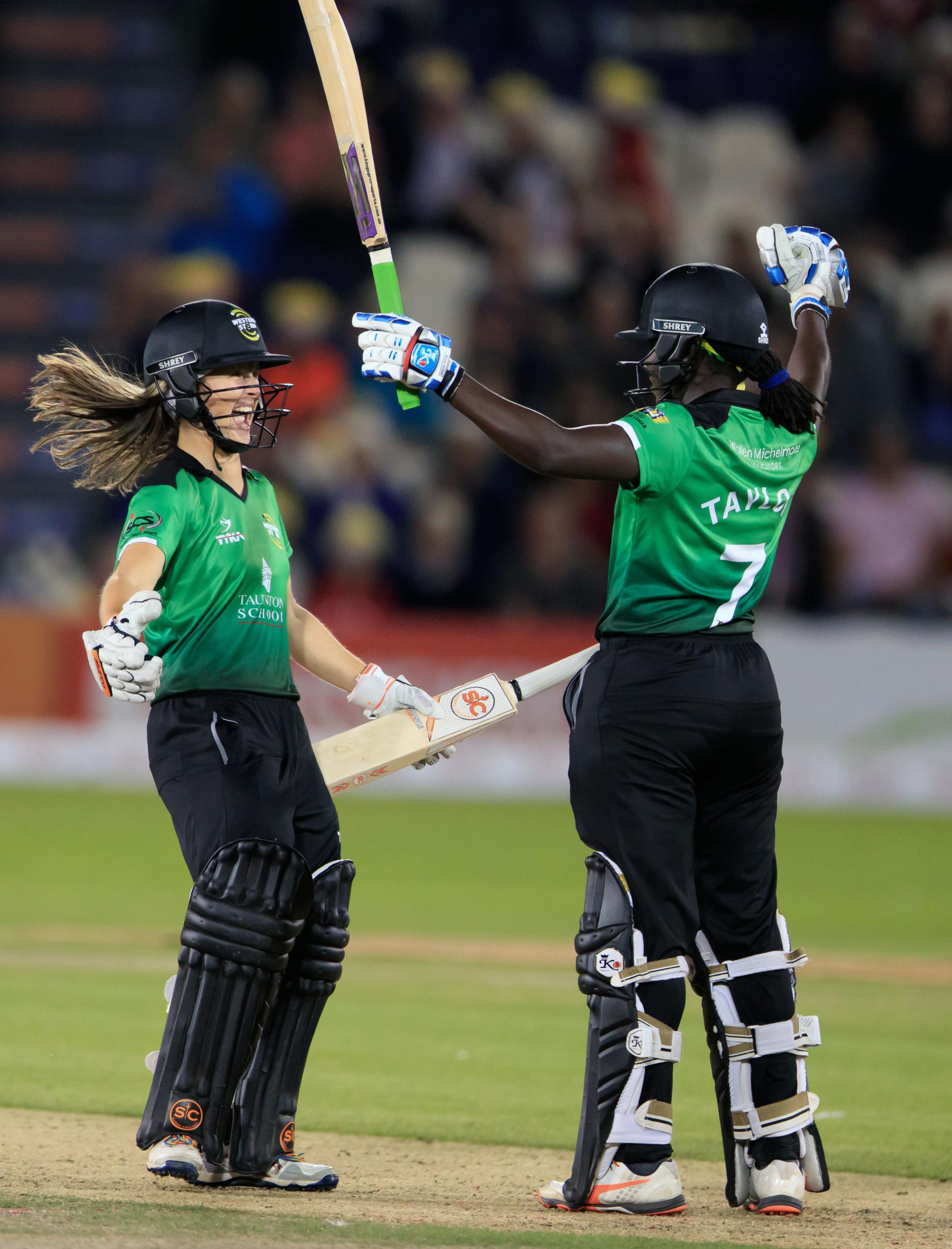WINNERS: Somerset's Sophie Luff (left) and Stafanie Taylor celebrate success at the 2017 KSL finals day.