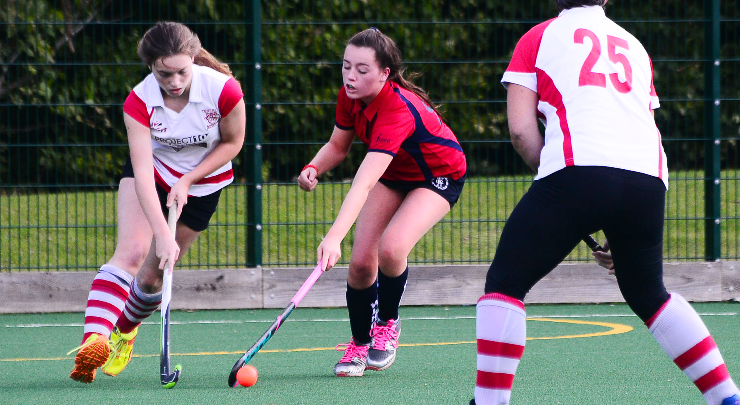 TUSSLE: Jodie Baker (left) in action for Taunton Civil Service 2nds. Pic: Steve Richardson