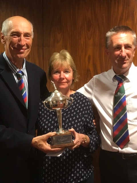 TRIUMPH: From left, Oake Manor Roffey Cup winners Colin Shepherd and Jill Loader with mixed golf organiser Mike How.