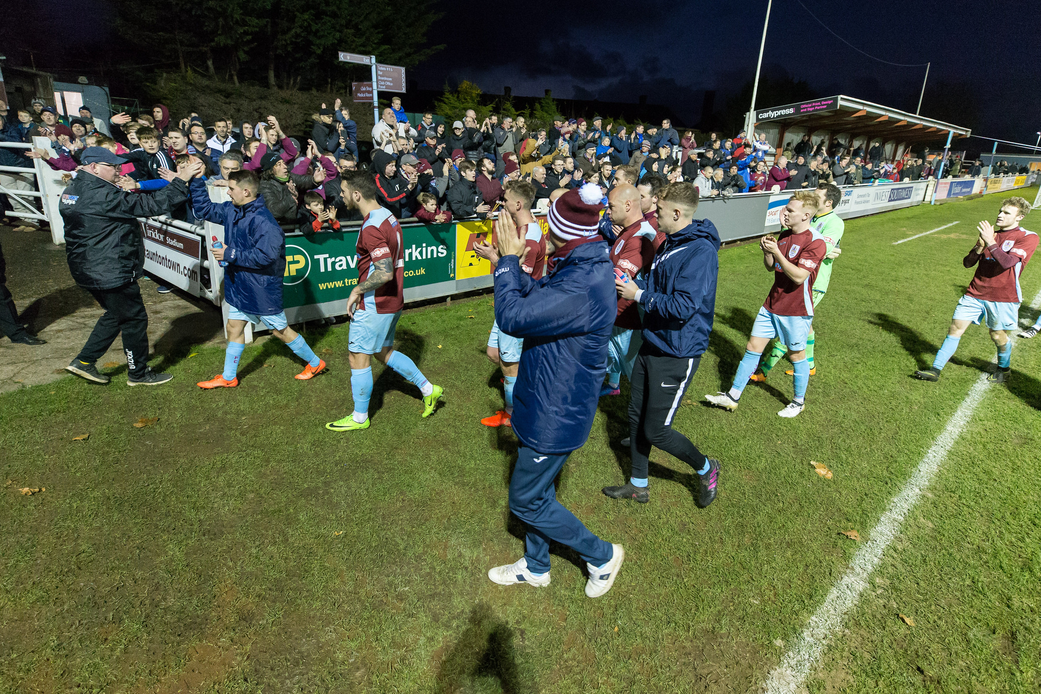 JOY: Taunton Town players and fans celebrate beating Concord Rangers in the FA Trophy. Pic: Tim Norbury