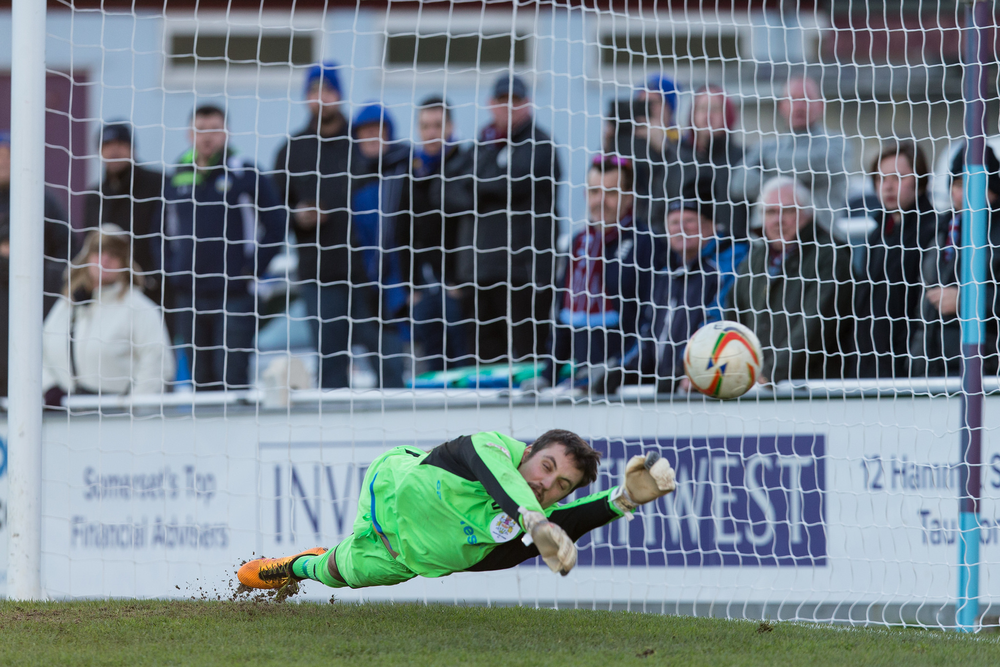 SAFE PAIR OF HANDS: Taunton Town goalkeeper Lloyd Irish saves a penalty against Concord Rangers last Saturday. Pic: Tim Norbury