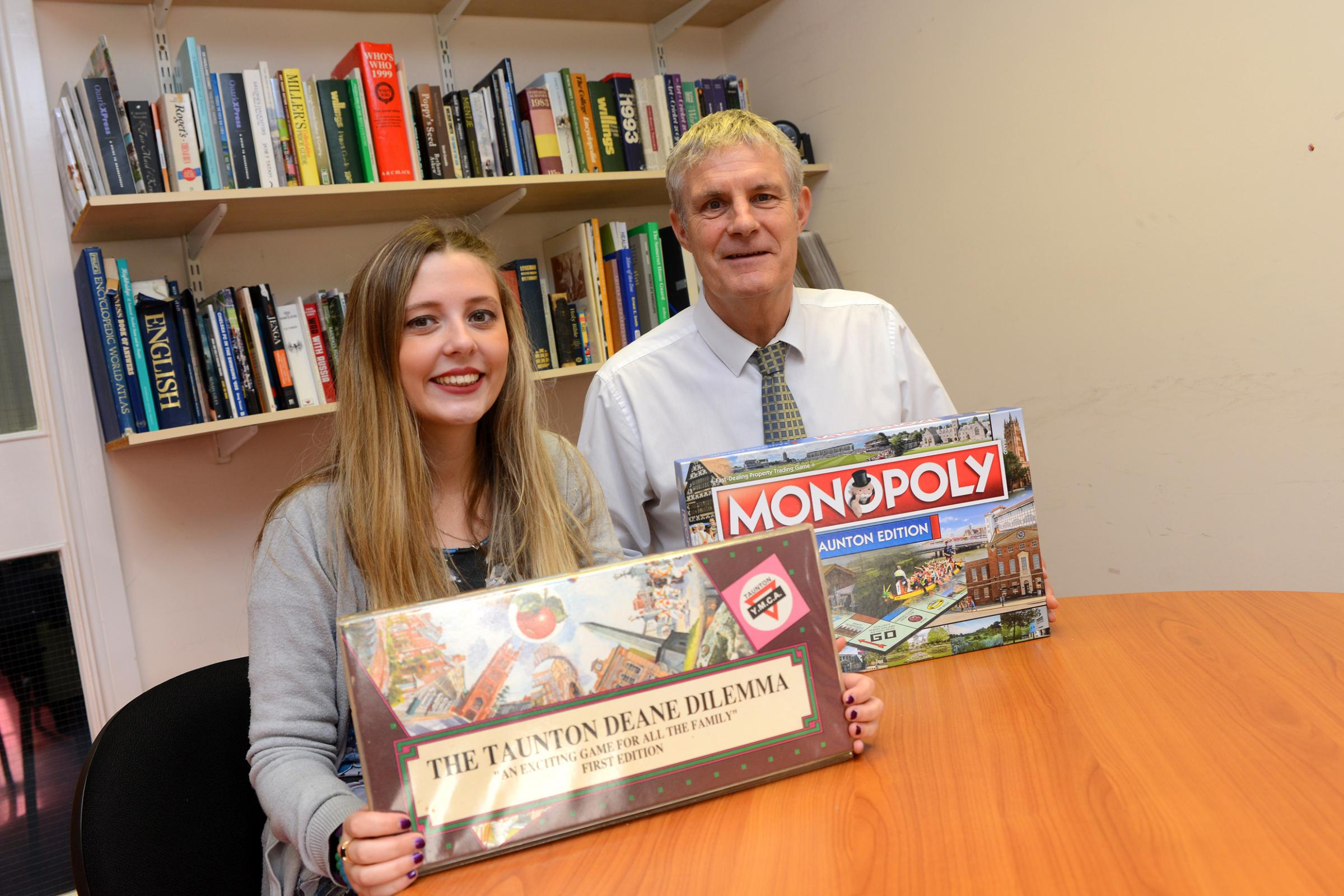 FUN AND GAMES: Reporters Amy Cole and Phil Hill with the Taunton Deane Dilemma and Monopoly games