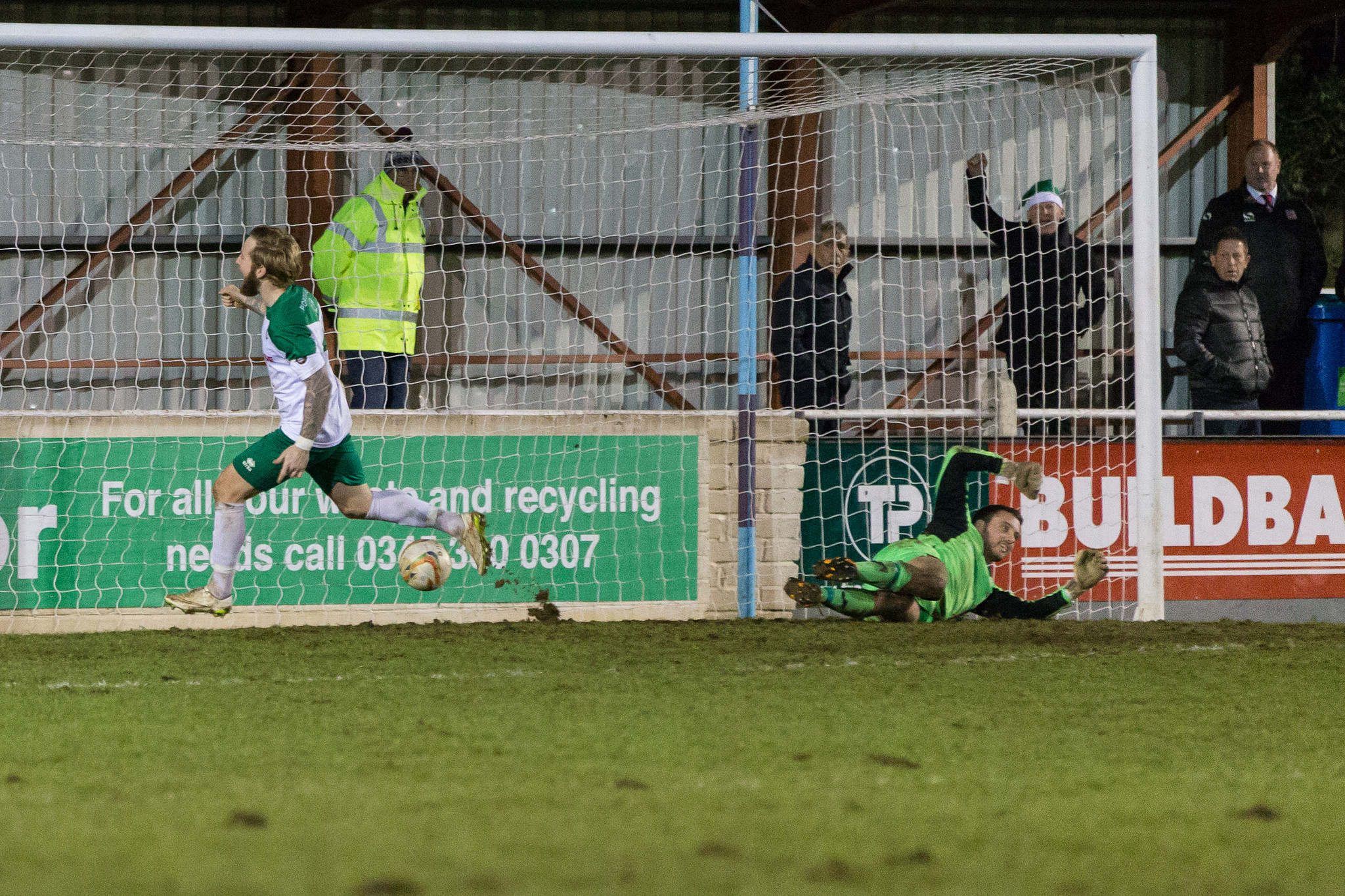TOUGH TO SWALLOW: Ben Swallow tucks his second goal past Lloyd Irish as Bognor Regis Town beat Taunton Town in the FA Trophy first round. Pic: Tim Norbury