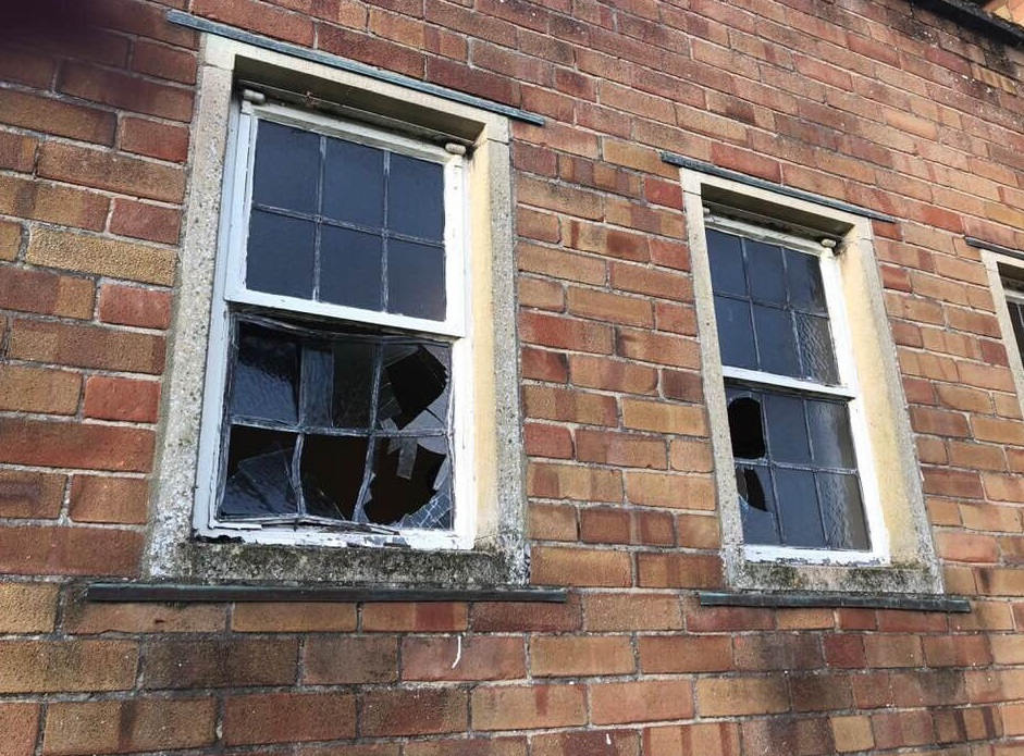 DAMAGE: The smashed windows at St Peter's Church in Priorswood