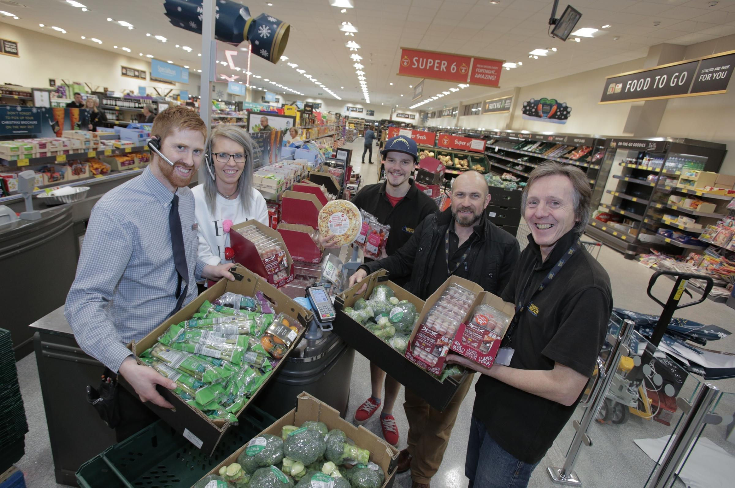 FESTIVE: Staff from Aldi ready to donate food