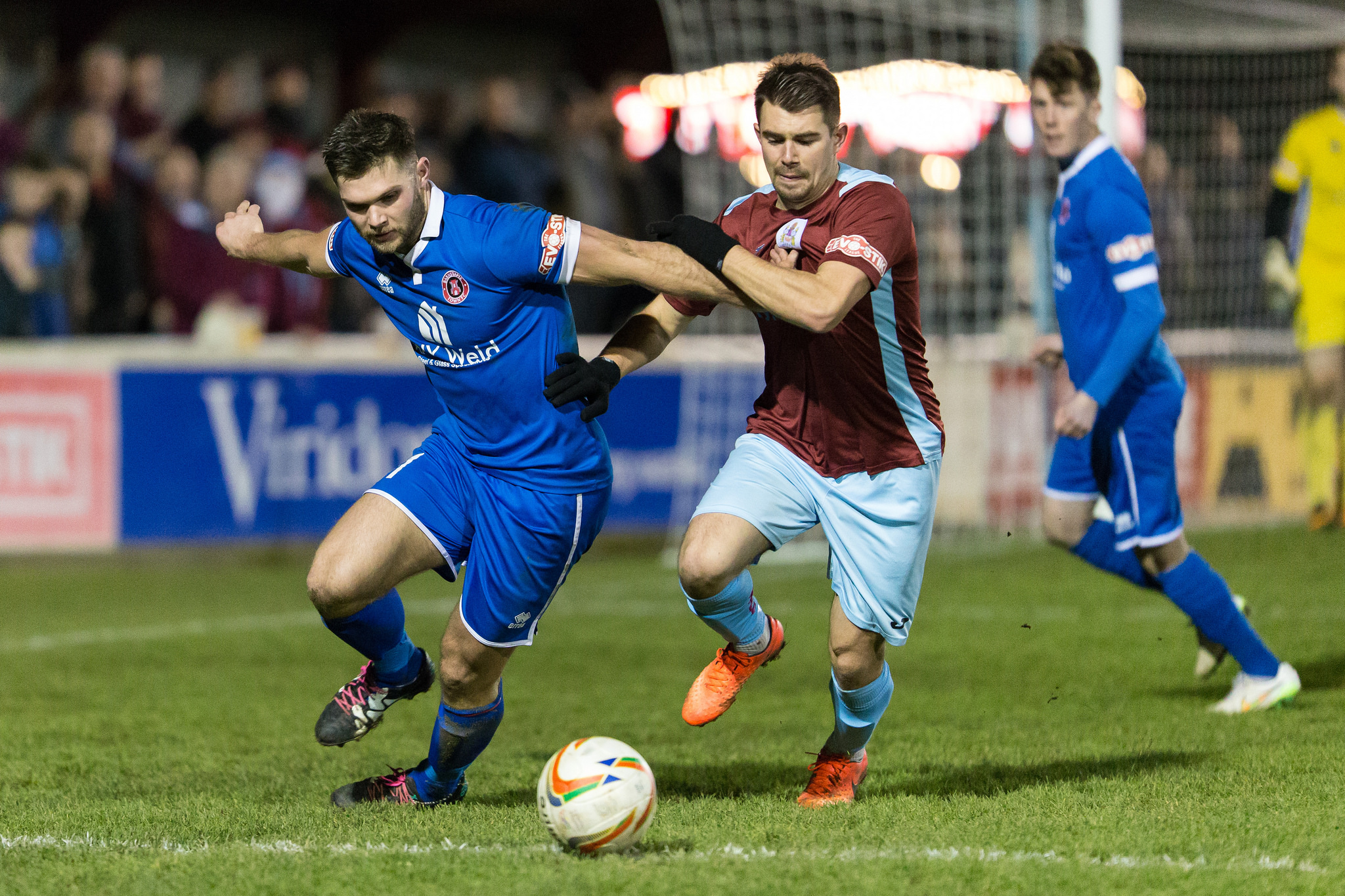 TREBLE: Ross Staley (claret kit) helped himself to three goals as Taunton Town won at AFC Totton. Pic: Tim Norbury