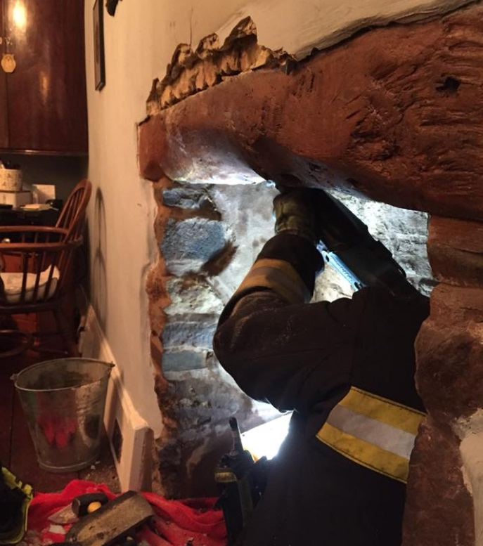 FIRE: A member of the Minehead crew attends the chimney fire at Dunster Steep (Picture: Minehead Fire Station)